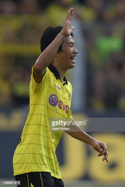Shinji Kagawa of Dortmund celebrates after scoring his team's second goal during the Bundesliga match between Borussia Dortmund and VfL Wolfsburg at...