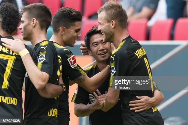 Shinji Kagawa of Dortmund celebrates after scoring his team`s second goal during the Bundesliga match between FC Augsburg and Borussia Dortmund at...
