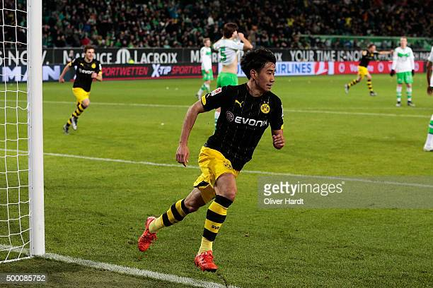 Shinji Kagawa of Dortmund celebrates after scoring their first goal during the First Bundesliga match at between VfL Wolfsburg and Borussia Dortmund...