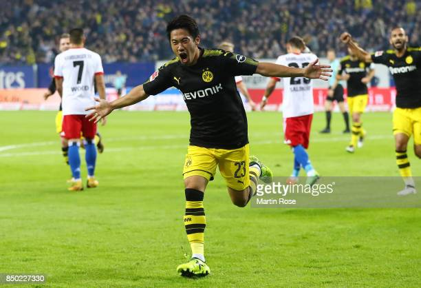 Shinji Kagawa of Dortmund celebrates his goal to make it 10 during the Bundesliga match between Hamburger SV and Borussia Dortmund at...
