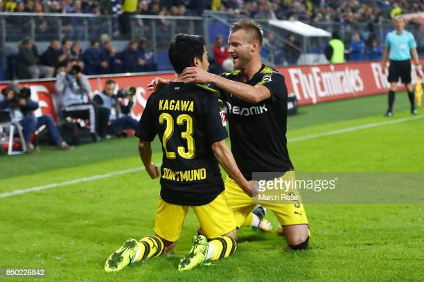 Shinji Kagawa of Dortmund celebrates his goal to make it 10 with Andrej Yaromolenko of Dortmund during the Bundesliga match between Hamburger SV and...