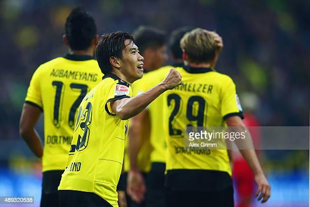 Shinji Kagawa of Dortmund celebrates his team's second goal during the Bundesliga match between Borussia Dortmund and Bayer Leverkusen at Signal...