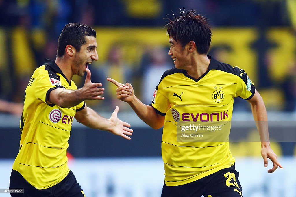 Shinji Kagawa (R) of Dortmund celebrates his team's second goal with team mate Henrikh Mkhitaryan during the Bundesliga match between Borussia Dortmund and Bayer Leverkusen at Signal Iduna Park on September 20, 2015 in Dortmund, Germany.
