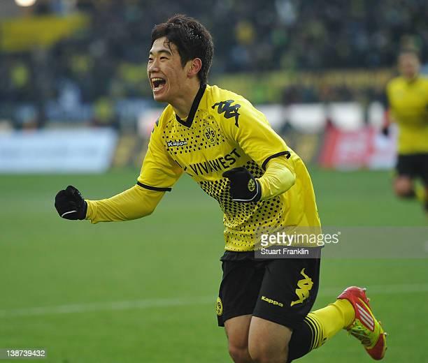 Shinji Kagawa of Dortmund celebrates scoring his goal during the Bundesliga match between Borussia Dortmund and Bayer 04 Leverkusen at Signal Iduna...