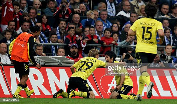 Shinji Kagawa of Dortmund celebrates scoring the first goal during the Bundesliga match between FC Schalke 04 and Borussia Dortmund at Veltins Arena...