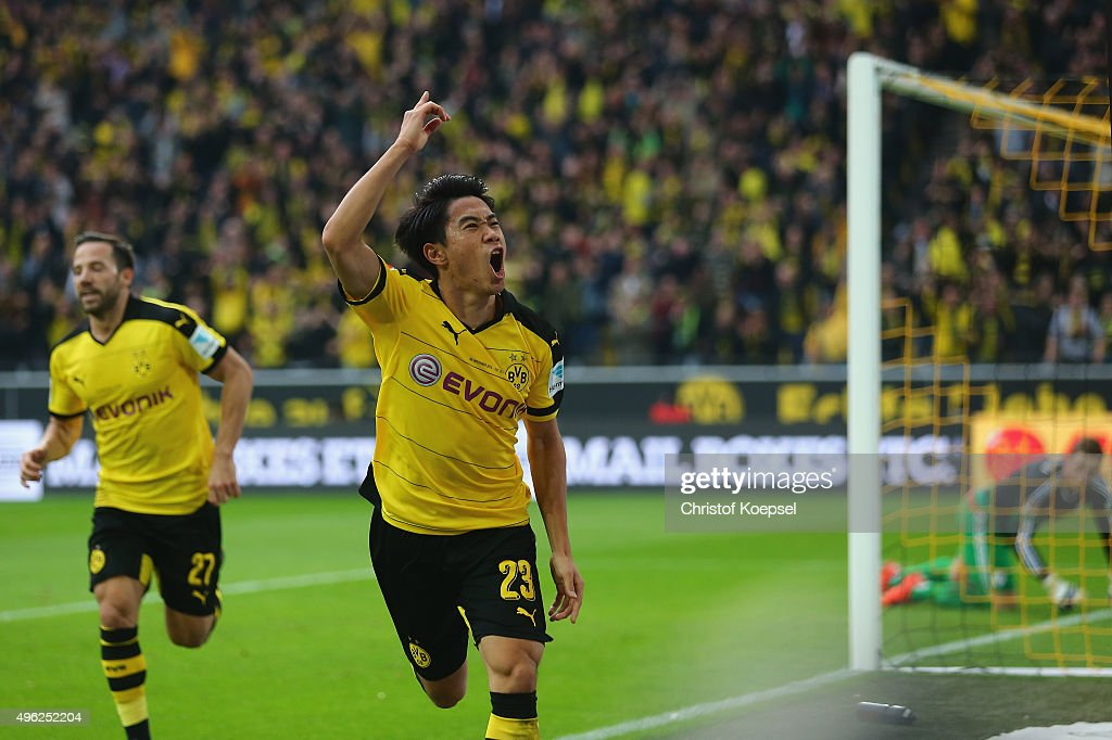 Shinji Kagawa of Dortmund celebrates the first goal during the Bundesliga match between Borussia Dortmund and FC Schalke 04 at Signal Iduna Park on November 8, 2015 in Dortmund, Germany.