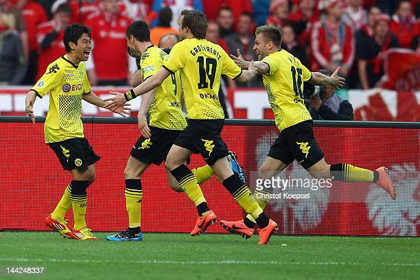 Shinji Kagawa of Dortmund celebrates the first goal with his team mates during the DFB Cup final match between Borussia Dortmund and FC Bayern...