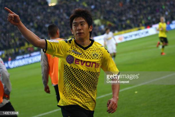 Shinji Kagawa of Dortmund celebrates the second goal during the 1 Bundesliga match between Borussia Dortmund an Borussia Moenchengladbach at Signal...