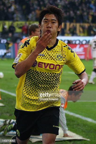 Shinji Kagawa of Dortmund celebrates the second goal during the 1. Bundesliga match between Borussia Dortmund an Borussia Moenchengladbach at Signal...
