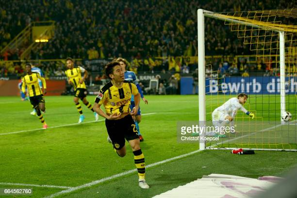 Shinji Kagawa of Dortmund celebrates the second goal during the Bundesliga match between Borussia Dortmund and Hamburger SV at Signal Iduna Park on...