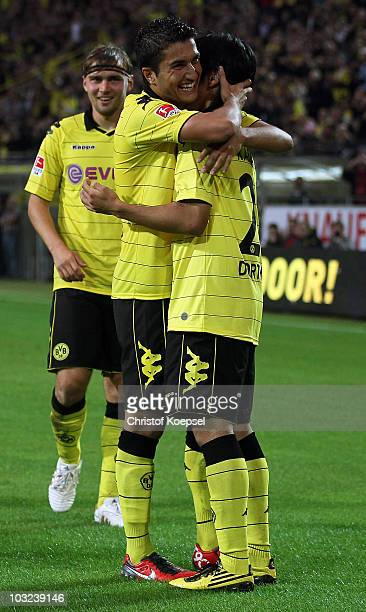 Shinji Kagawa of Dortmund celebrates the second goal with Nuri Sahin during the preseason friendly match between Borussia Dortmund and Manchester...