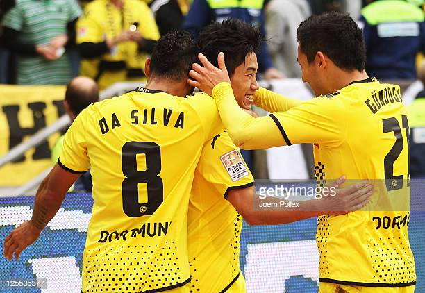 Shinji Kagawa of Dortmund celebrates with his team mates after scoring his team's first goal during the Bundesliga match between Hanover 96 and...