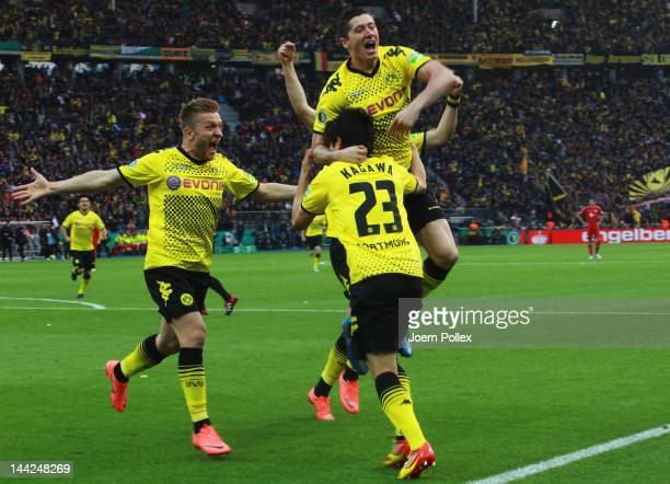Shinji Kagawa of Dortmund celebrates with his team mates after scoring his team's first goal during the DFB Cup final match between Borussia Dortmund...