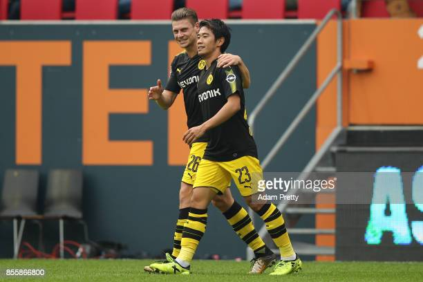 Shinji Kagawa of Dortmund celebrates with Lukasz Piszczek of Dortmund after he scored his teams second goal to make it 21 during the Bundesliga match...