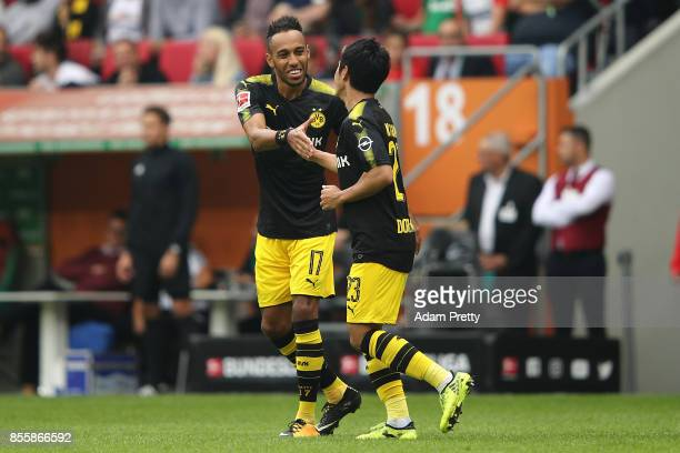Shinji Kagawa of Dortmund celebrates with PierreEmerick Aubameyang of Dortmund after he scored his teams second goal to make it 21 during the...
