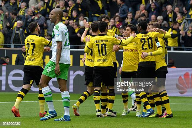 Shinji Kagawa of Dortmund celebrates with team mates after scoring the opening goal during the Bundesliga match between Borussia Dortmund and VfL...