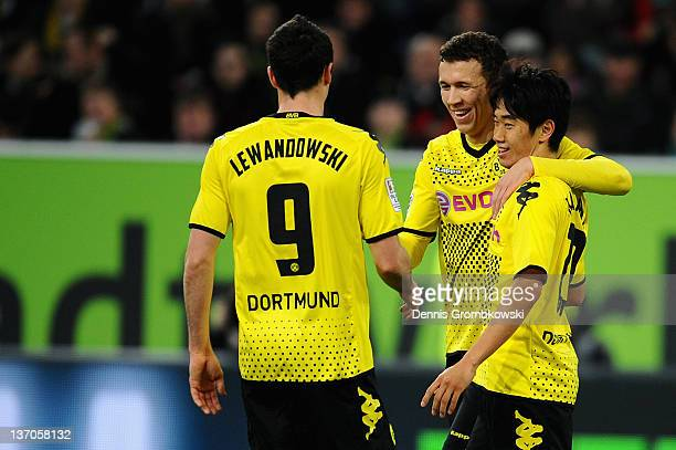 Shinji Kagawa of Dortmund celebrates with teammates after scoring his team's opening goal during the Stadtwerke Duesseldorf Wintercup 2012 match...