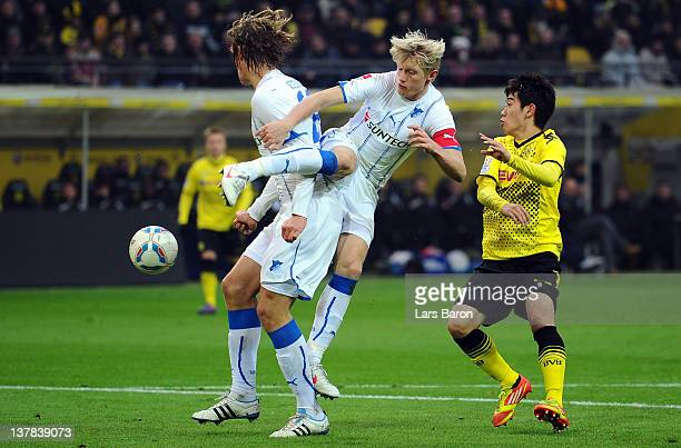 Shinji Kagawa of Dortmund challenges Andreas Beck and Jannik Vestergaard of Hoffenheim during the Bundesliga match between Borussia Dortmund and 1899...