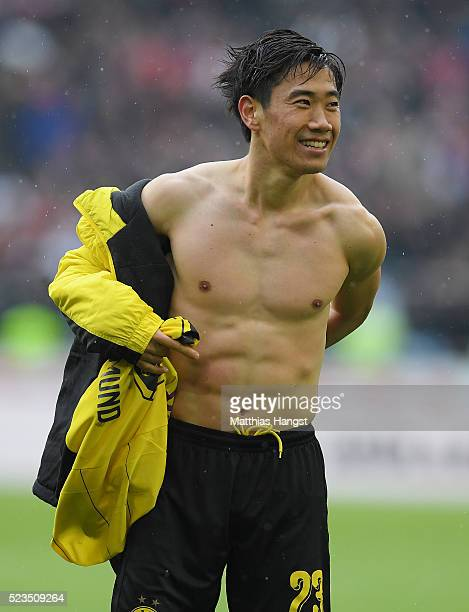 Shinji Kagawa of Dortmund changes his shirt after the Bundesliga match between VfB Stuttgart and Borussia Dortmund at MercedesBenz Arena on April 23...