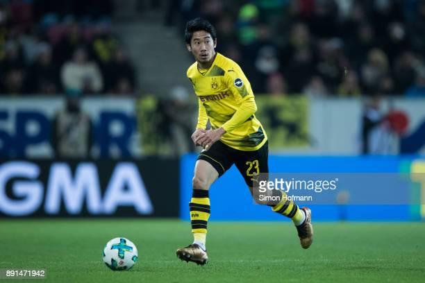 Shinji Kagawa of Dortmund controls the ball during the Bundesliga match between 1 FSV Mainz 05 and Borussia Dortmund at Opel Arena on December 12...