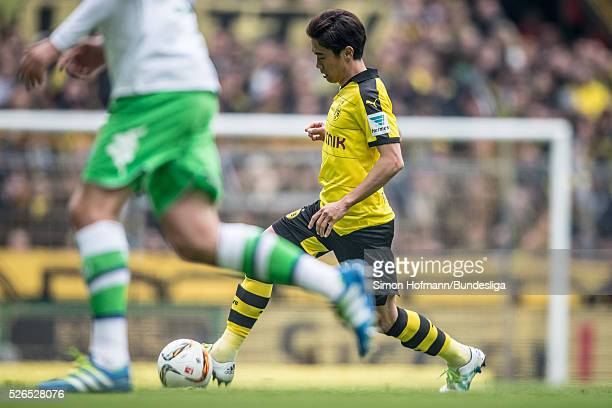 Shinji Kagawa of Dortmund controls the ball during the Bundesliga match between Borussia Dortmund and VfL Wolfsburg at Signal Iduna Park on April 30...