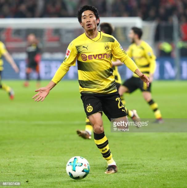 Shinji Kagawa of Dortmund controls the ball during the Bundesliga match between Bayer 04 Leverkusen and Borussia Dortmund at BayArena on December 2...