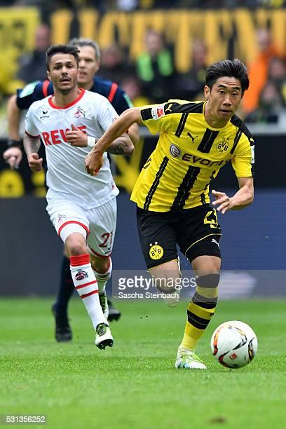 Shinji Kagawa of Dortmund goes past Leonardo Bittencourt of Koeln during the Bundesliga match between Borussia Dortmund and 1 FC Koeln at Signal...