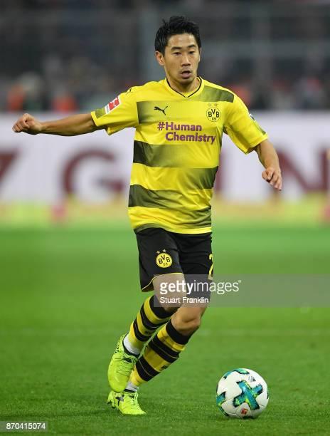 Shinji Kagawa of Dortmund in action during the Bundesliga match between Borussia Dortmund and FC Bayern Muenchen at Signal Iduna Park on November 4...