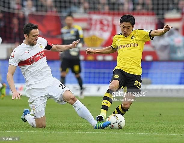 Shinji Kagawa of Dortmund is challenged by Christian Gentner of Stuttgart during the Bundesliga match between VfB Stuttgart and Borussia Dortmund at...