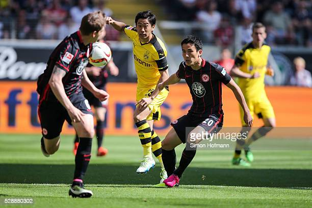 Shinji Kagawa of Dortmund is challenged by Makoto Hasebe of Frankfurt during the Bundesliga match between Eintracht Frankfurt and Borussia Dortmund...