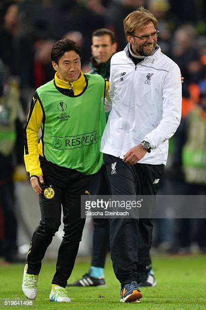 Shinji Kagawa of Dortmund is hugged by head coach Juergen Klopp of Liverpool after the UEFA Europa League quarter final first leg match between...