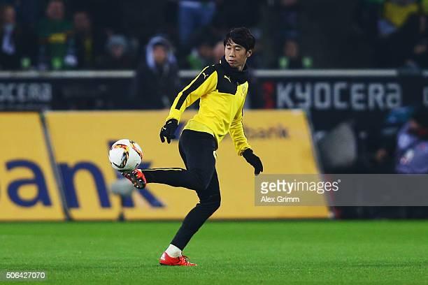 Shinji Kagawa of Dortmund juggles with the ball at halftime of the Bundesliga match between Borussia Moenchengladbach and Borussia Dortmund at...