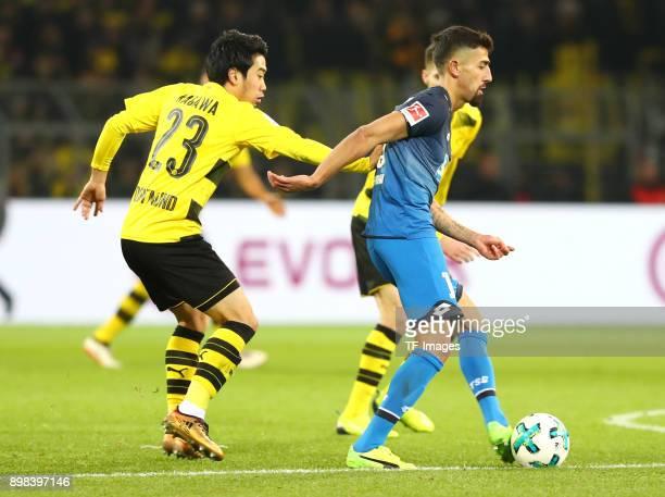 Shinji Kagawa of Dortmund Julian Weigl of Dortmund and Kerem Demirbay of Hoffenheim battle for the ball during the Bundesliga match between Borussia...