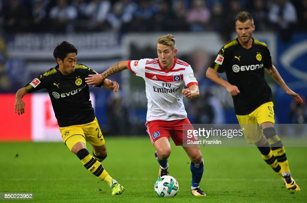 Shinji Kagawa of Dortmund Lewis Holtby of Hamburg Andrej Yaromolenko of Dortmund during the Bundesliga match between Hamburger SV and Borussia...