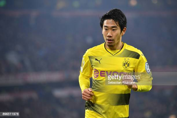 Shinji Kagawa of Dortmund looks on during the DFB Cup match between Bayern Muenchen and Borussia Dortmund at Allianz Arena on December 20 2017 in...