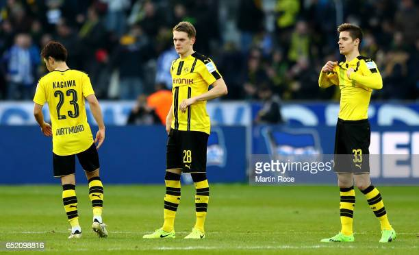 Shinji Kagawa of Dortmund Matthias Ginter of Dortmund and Julian Weigl of Dortmund are looking dejected after loosing the Bundesliga match between...