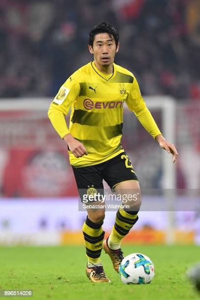 Shinji Kagawa of Dortmund plays the ball during the DFB Cup match between Bayern Muenchen and Borussia Dortmund at Allianz Arena on December 20 2017...