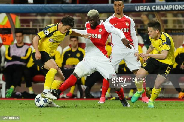 Shinji Kagawa of Dortmund Raphael Guerreiro of Dortmund and Tiemoue Bakayoko of Monaco battle for the ball during the UEFA Champions League quarter...