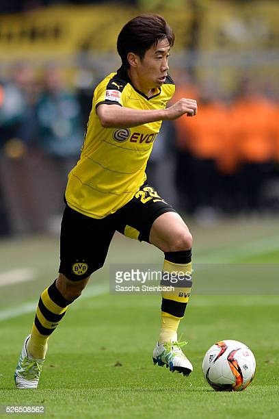 Shinji Kagawa of Dortmund runs with the ball during the Bundesliga match between Borussia Dortmund and VfL Wolfsburg at Signal Iduna Park on April 29...