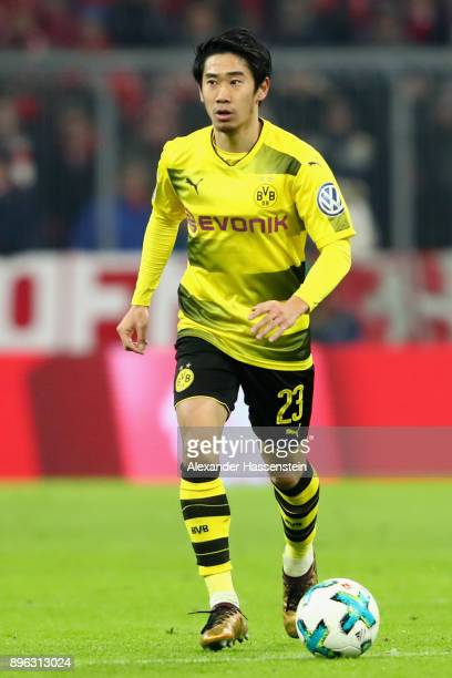 Shinji Kagawa of Dortmund runs with the ball during the DFB Cup match between Bayern Muenchen and Borussia Dortmund at Allianz Arena on December 20...