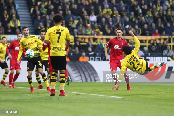 Shinji Kagawa of Dortmund scores a goal to make it 10 during the Bundesliga match between Borussia Dortmund and SportClub Freiburg at Signal Iduna...