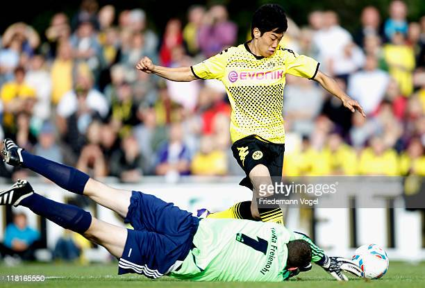 Shinji Kagawa of Dortmund scores his team's first goal during preseason friendly match between Team Sauerland and Borussia Dortmund on July 4 2011 in...