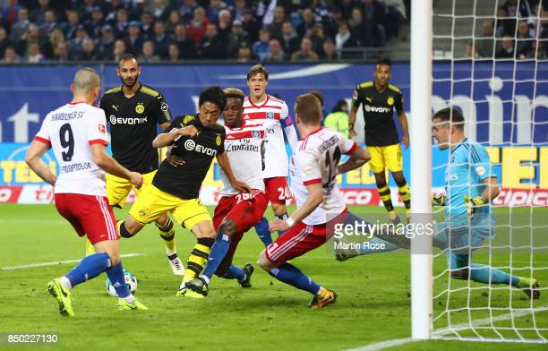 Shinji Kagawa of Dortmund scores his teams first goal to make it 10 during the Bundesliga match between Hamburger SV and Borussia Dortmund at...