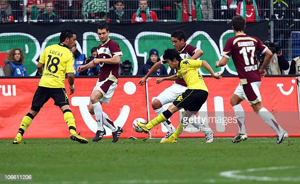 Shinji Kagawa of Dortmund scores his team's opening goal during the Bundesliga match between Hannover 96 and Borussia Dortmund at AWD Arena on...