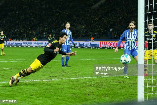 Shinji Kagawa of Dortmund scores the team`s first goal during the Bundesliga match between Hertha BSC and Borussia Dortmund at Olympiastadion on...