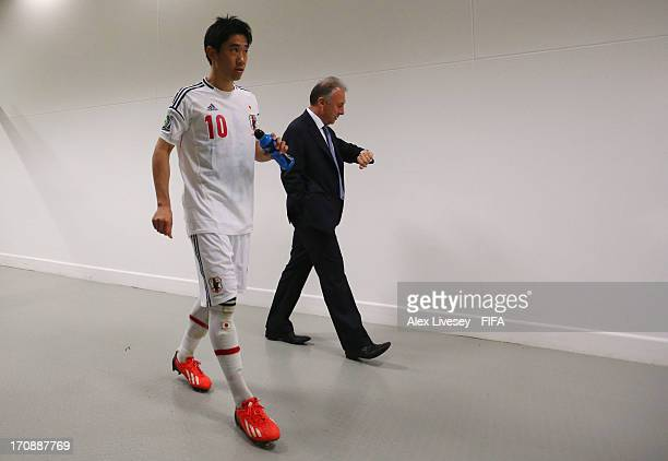 Shinji Kagawa of Japan and Alberto Zaccheroni head coach of Japan head for the dressing room after the FIFA Confederations Cup Brazil 2013 Group A...