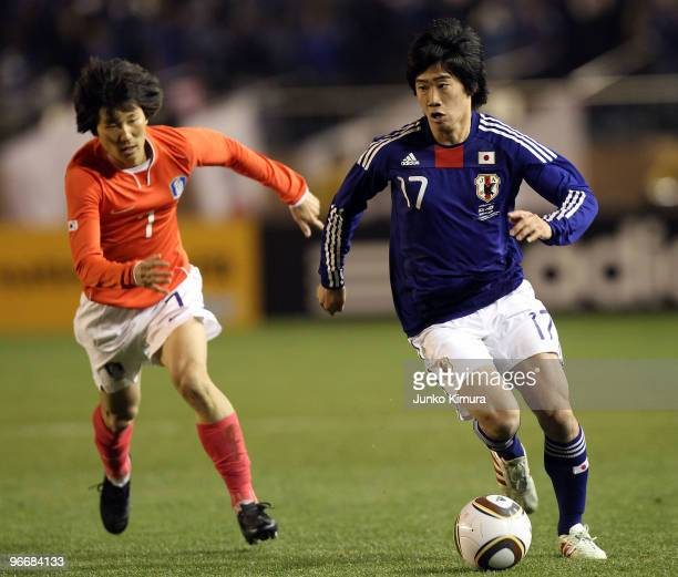Shinji Kagawa of Japan and Jae Sung Kim of South Korea compete for the ball during the East Asian Football Championship 2010 match between Japan and...
