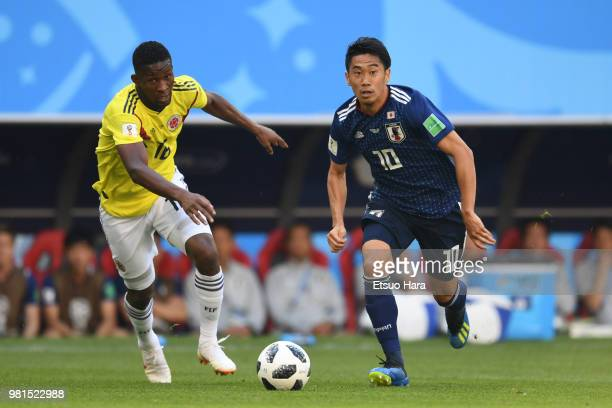 Shinji Kagawa of Japan and Jefferson Lerma of Colombia compete for the ball during the 2018 FIFA World Cup Russia group H match between Colombia and...