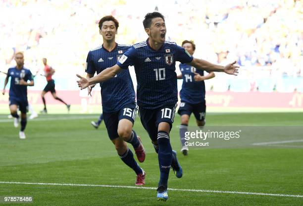 Shinji Kagawa of Japan celebrates after scoring a penalty for his team's first goal during the 2018 FIFA World Cup Russia group H match between...