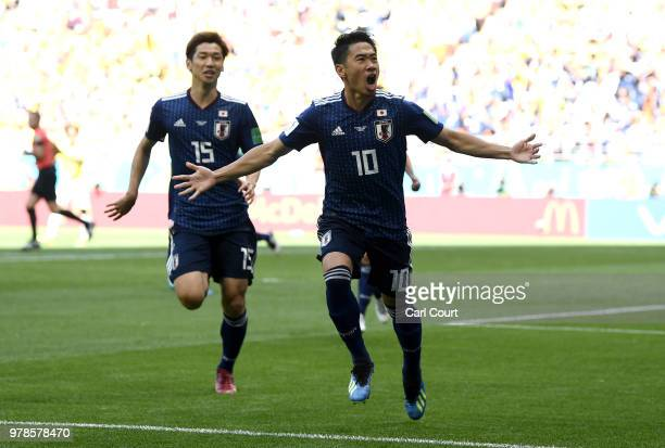 Shinji Kagawa of Japan celebrates after scoring his team's first goal with team mate Yuya Osako during the 2018 FIFA World Cup Russia group H match...